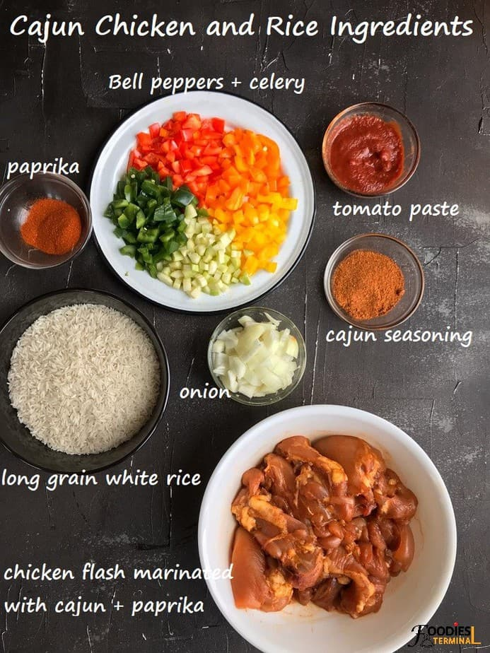 Instant pot cajun chicken and rice ingredients in bowls on a black surface