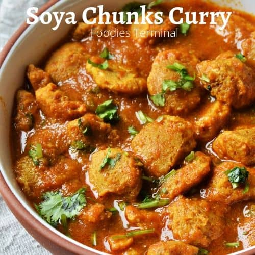 Soya Chunks Curry made in instant Pot in a red rimmed bowl