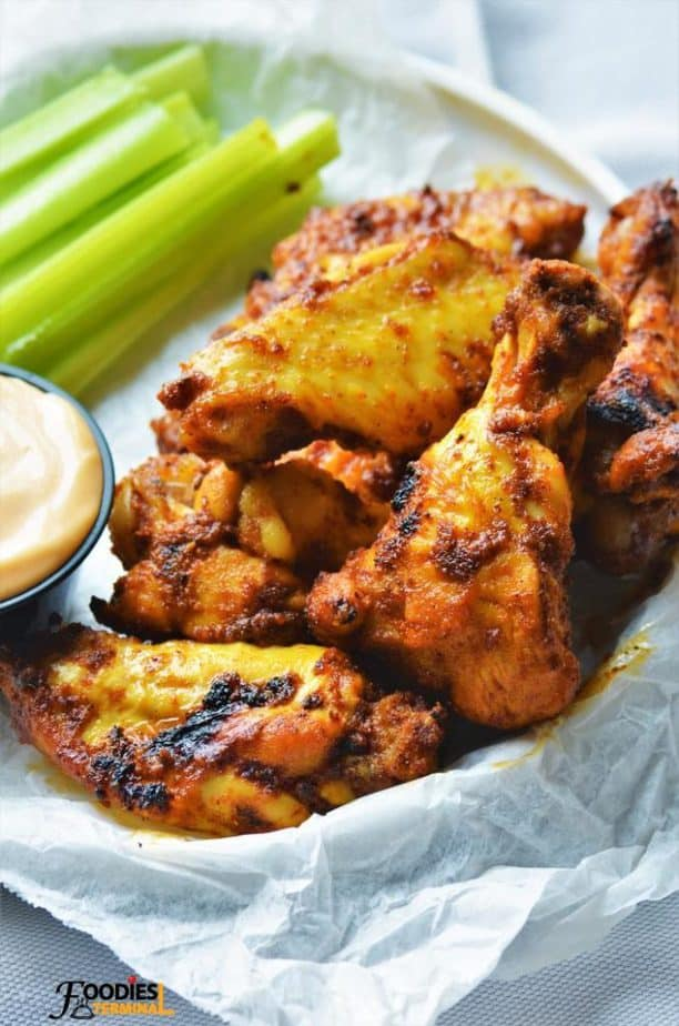 Tandoori wings served in a basket with celery sticks