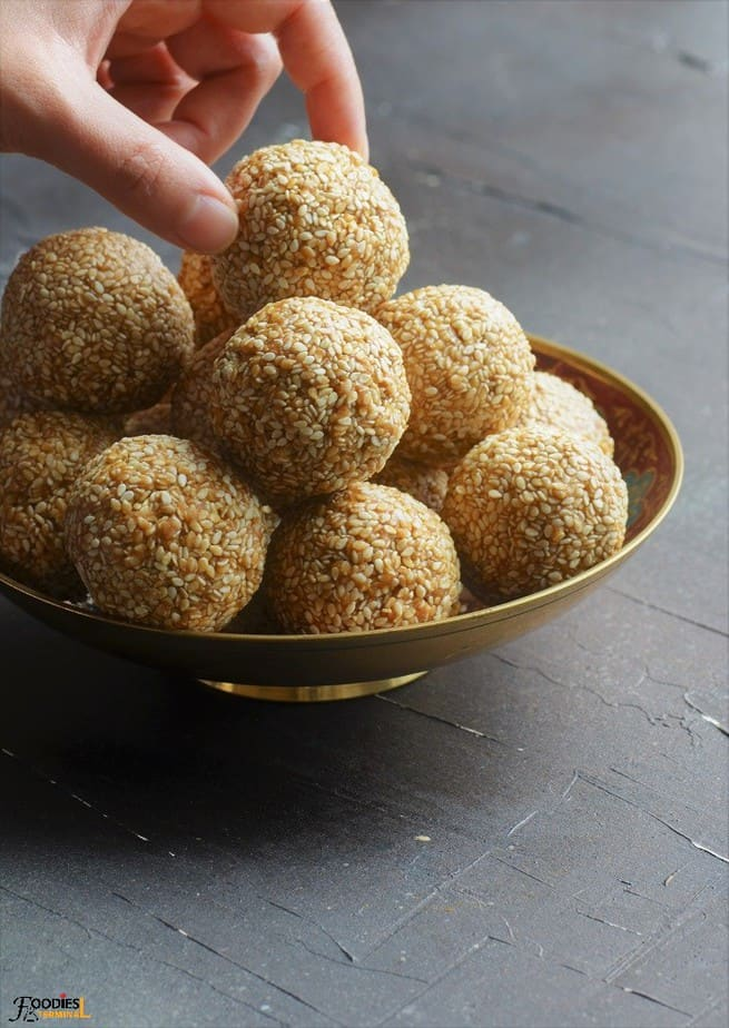Til Laddu stacked on a golden bowl