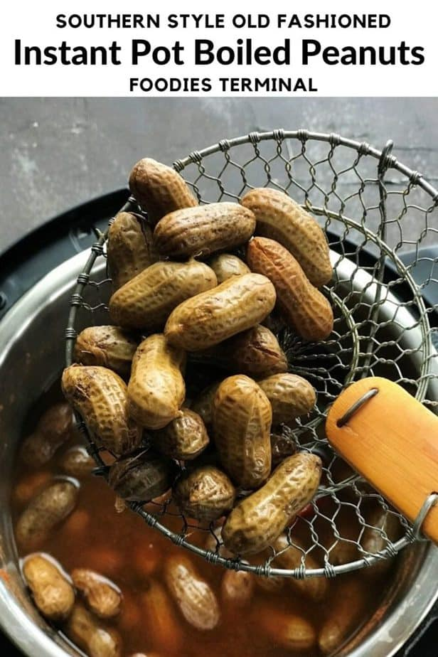instant pot boiled peanuts in a slotted spoon