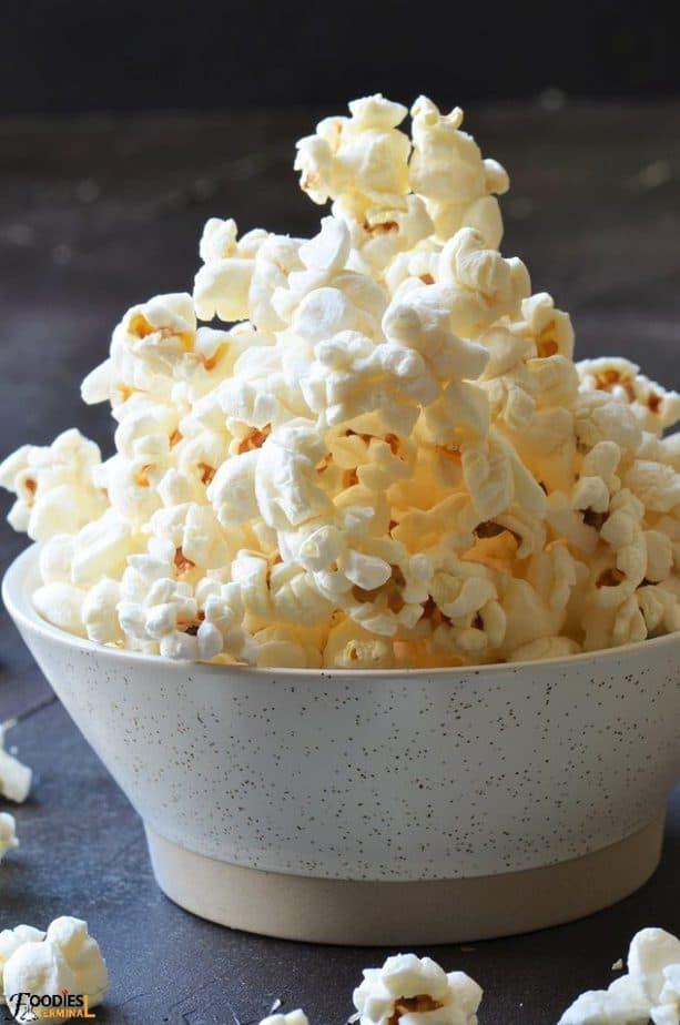 Instant pot popcorn in a beige bowl