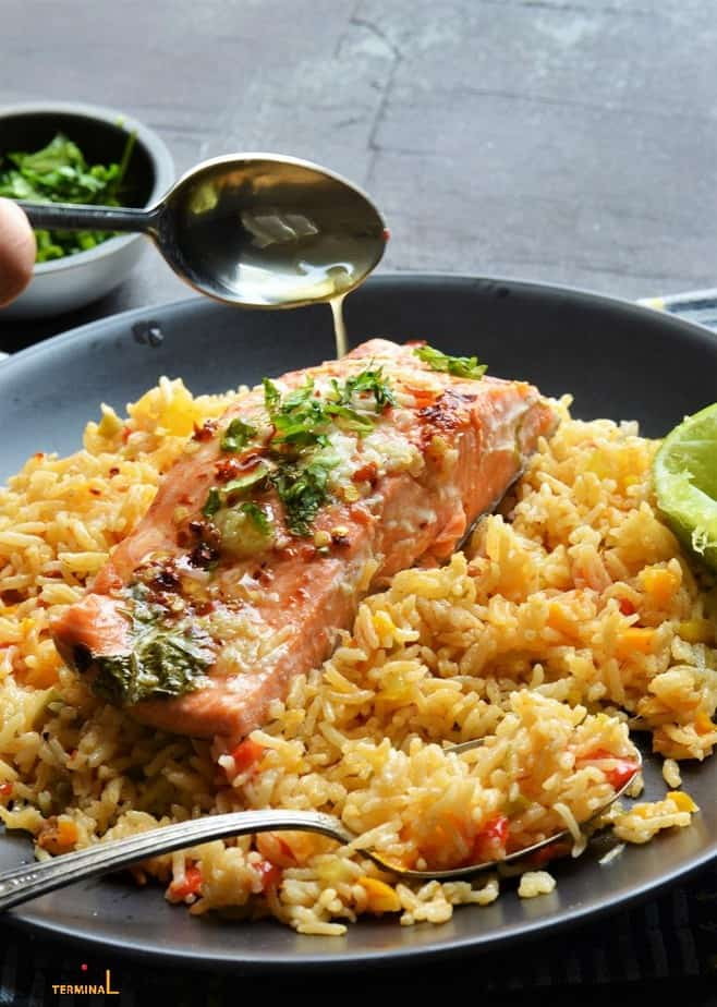 Instant Pot Salmon and Rice served and poured with lemon butter sauce