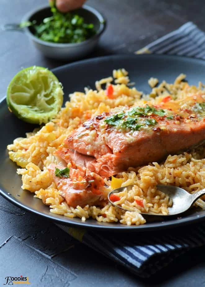 Instant Pot Salmon and Rice served on a black plate with lime