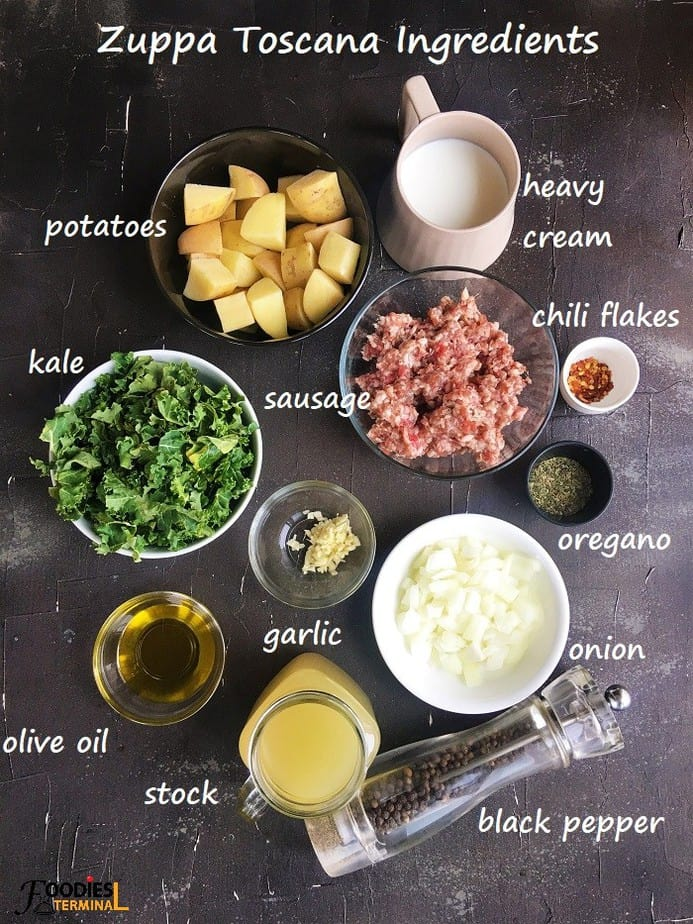 Pressure cooker zuppa toscana ingredients in bowls on black surface