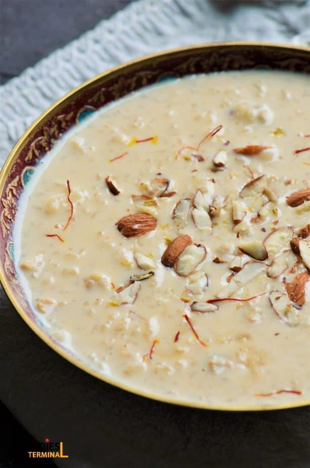 Pressure cooker rice kheer garnished with saffron & almonds