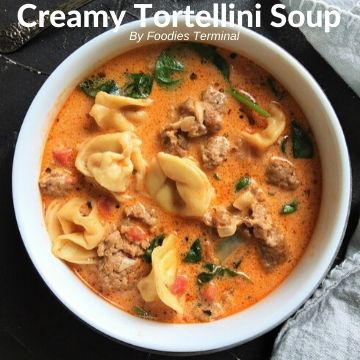 Instant Pot creamy tortellini soup in a white soup bowl
