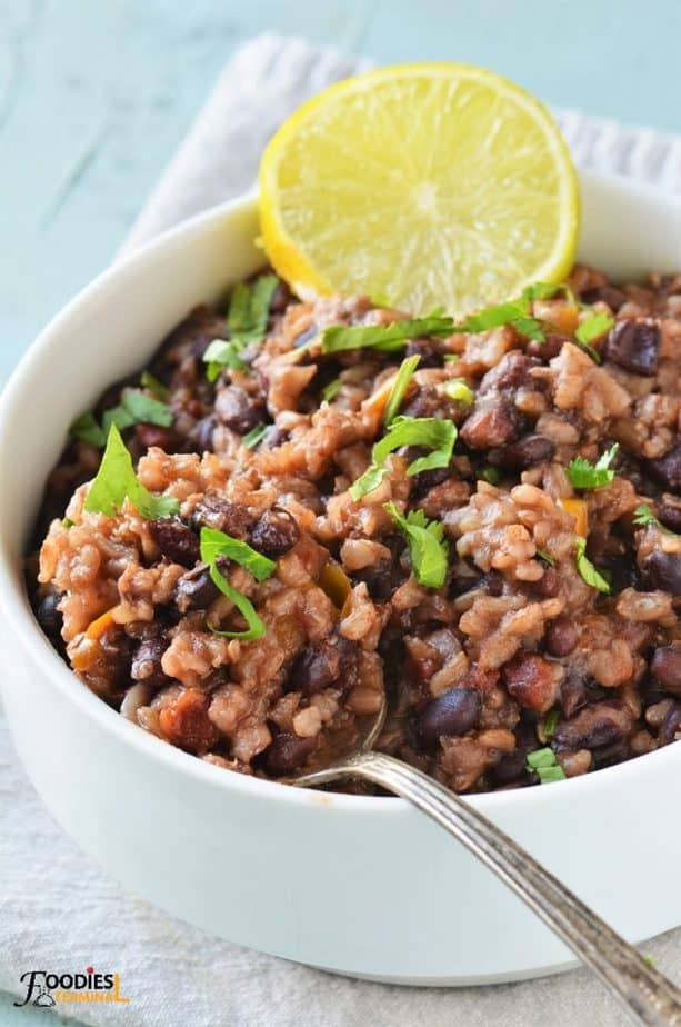 Instant Pot Black Beans and Rice served with lime wedge