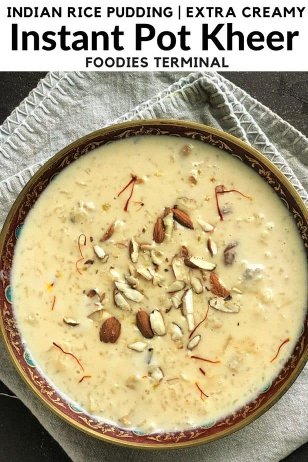 Kheer in a brass bowl with almonds & saffron