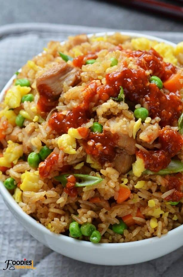 instant pot chicken fried rice served with red hot sauce