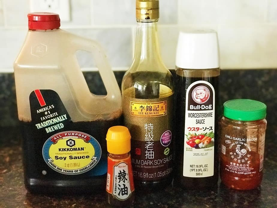 Sauces and sesame oil in bottles used in the recipe
