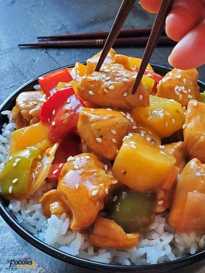 Instant Pot Sweet and Sour Chicken served on white rice with chopsticks