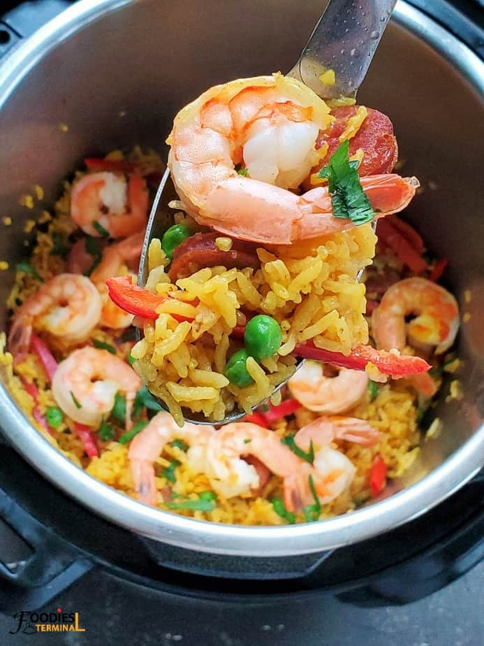 Shrimp Paella scooped out in a ladle from instant pot