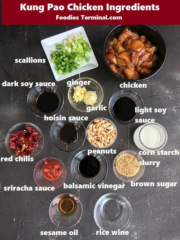 kung pao chicken ingredients in various sized bowls on a black surface