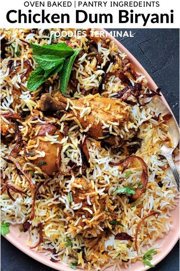 indian chicken dum biryani made in oven served in a peach plate