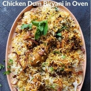 Chicken Dum Biryani in an oval plate garnished with mint