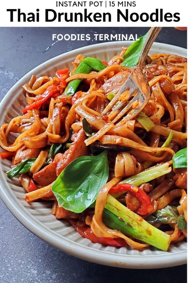 instant pot thai drunken noodles pad kee mao being lifted with a fork