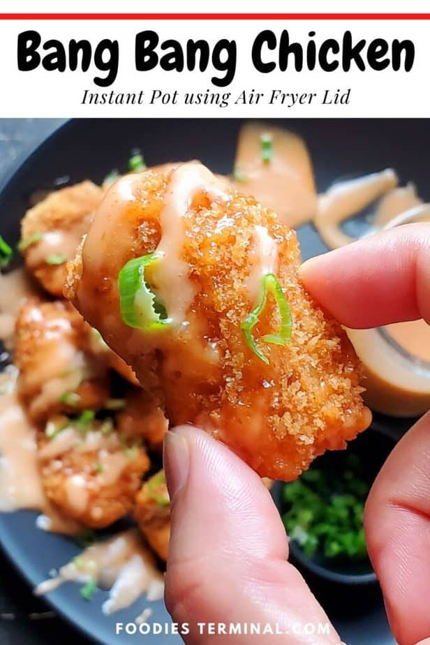 air fryer bang bang chicken just one piece lifted with fingers