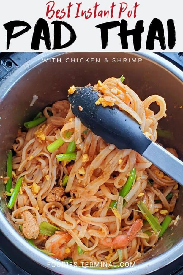 instant pot chicken shrimp pad thai being lifted with tong from the pressure cooker