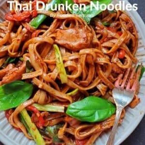 instant pot drunken noodles with basil in a beige plate