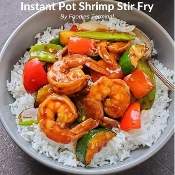 instant pot stir fry shrimp on white rice in a grey bowl