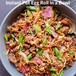 Egg Roll in a bowl garnished with scallions in a grey bowl