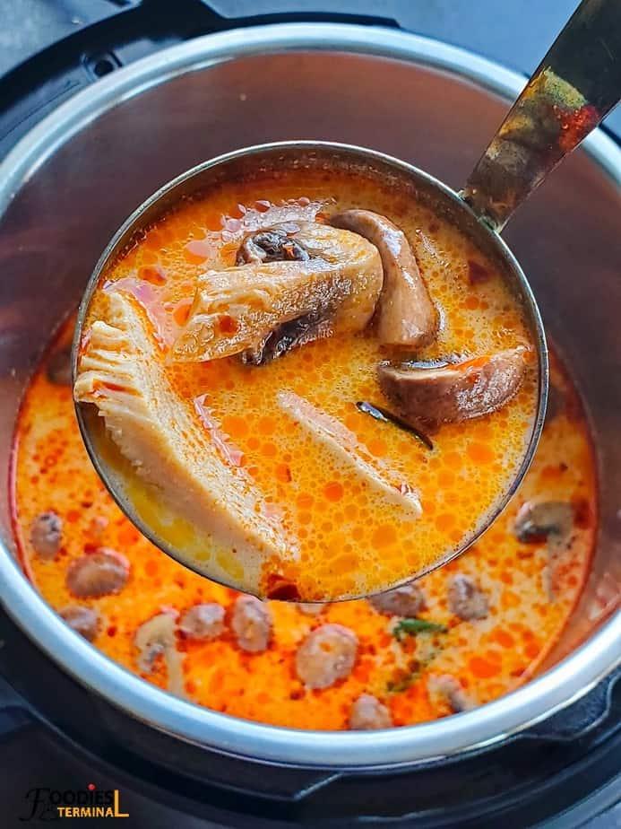 instant pot tom kha gai soup in a ladle