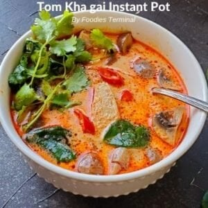 Instant Pot Tom Kha Gai in white bowl with spoon
