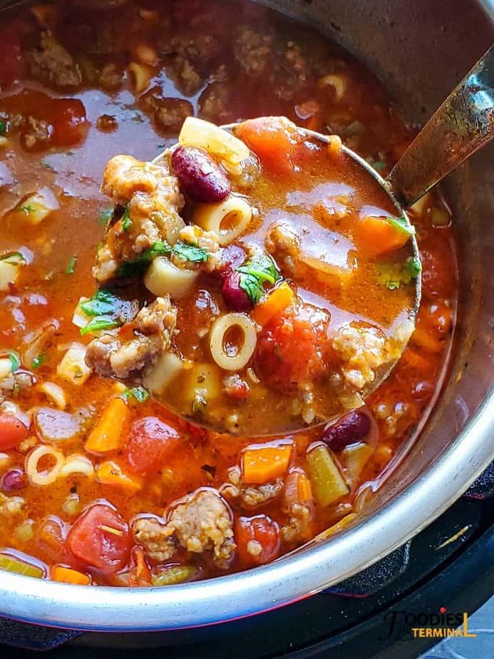 instant pot pasta e fagioli soup in a ladle