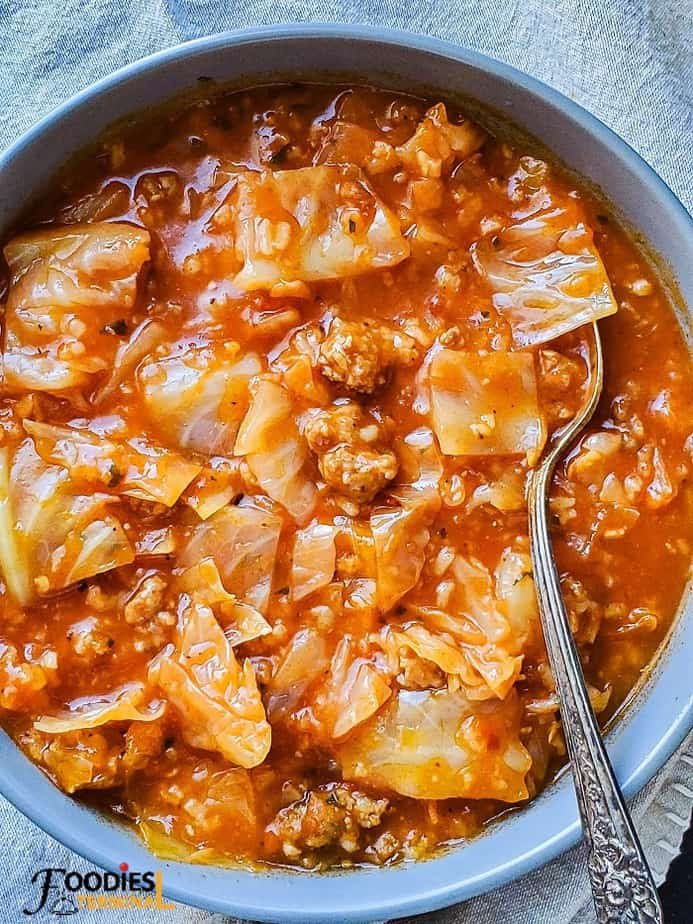 unstuffed cabbage roll soup instant pot in a grey bowl with spoon