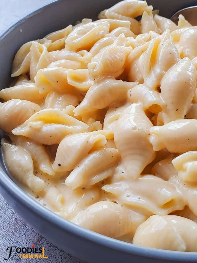 Creamy instant pot velveeta shells and cheese in a grey bowl