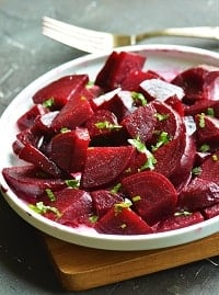 diced beets served on a white plate garnished with parsley