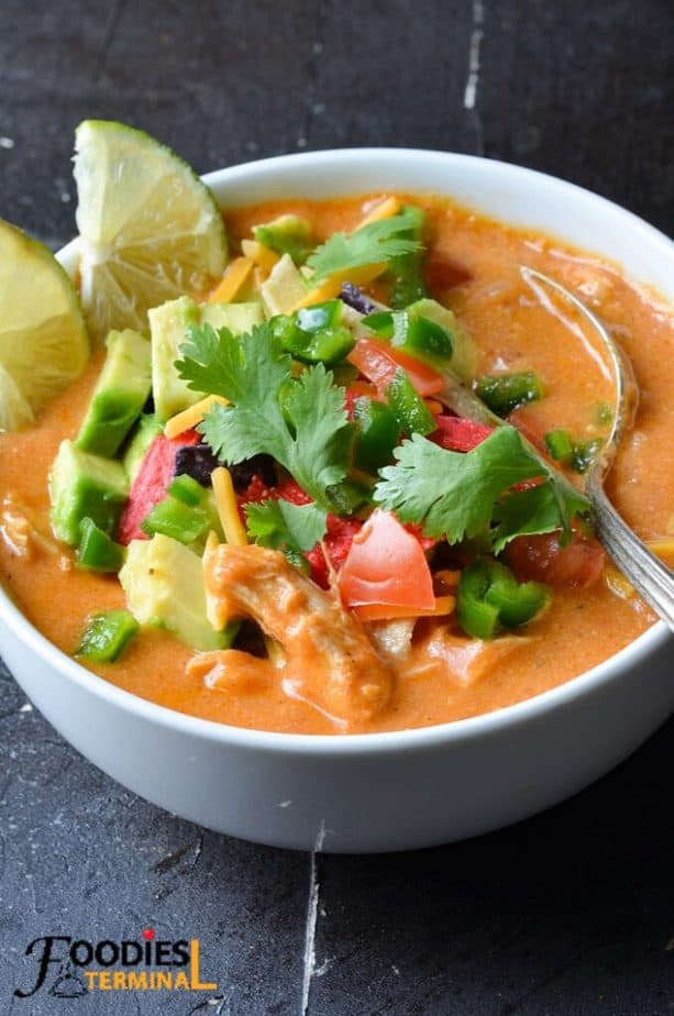 Chili's chicken enchilada soup instant pot in a white bowl with a spoon