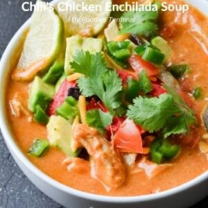 chili's enchilada soup instant pot in a white bowl with toppings