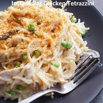 chicken tetrazzini instant pot recipe on a black plate & garnished with butter toasted bread crumbs