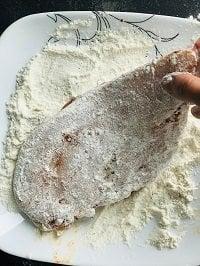 dredging chicken breast with flour
