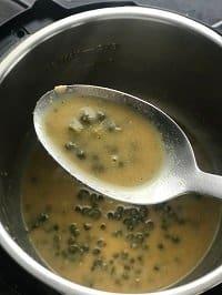 piccata sauce in a ladle