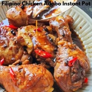 drizzling adobo sauce over instant pot chicken adobo