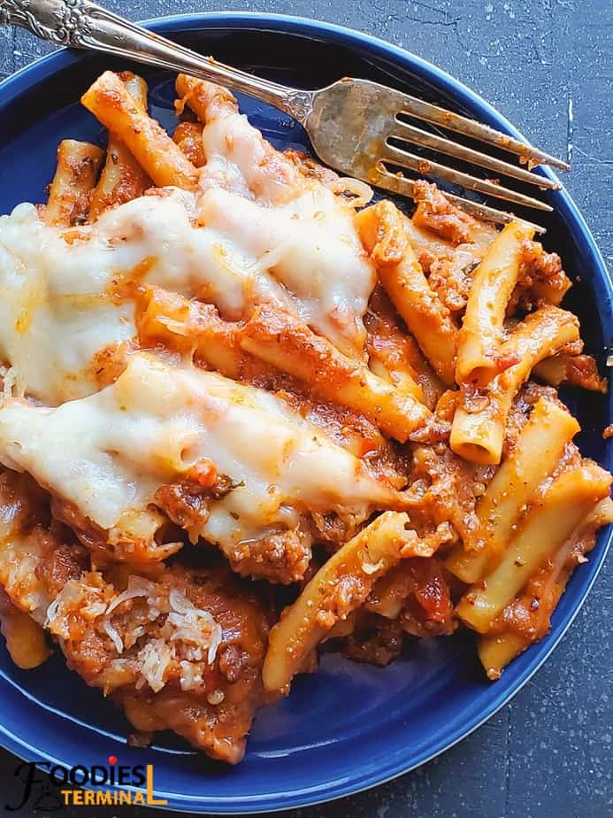 easy instant pot baked ziti with ricotta on a blue plate with a fork