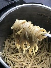 detangling cooked pasta with forks