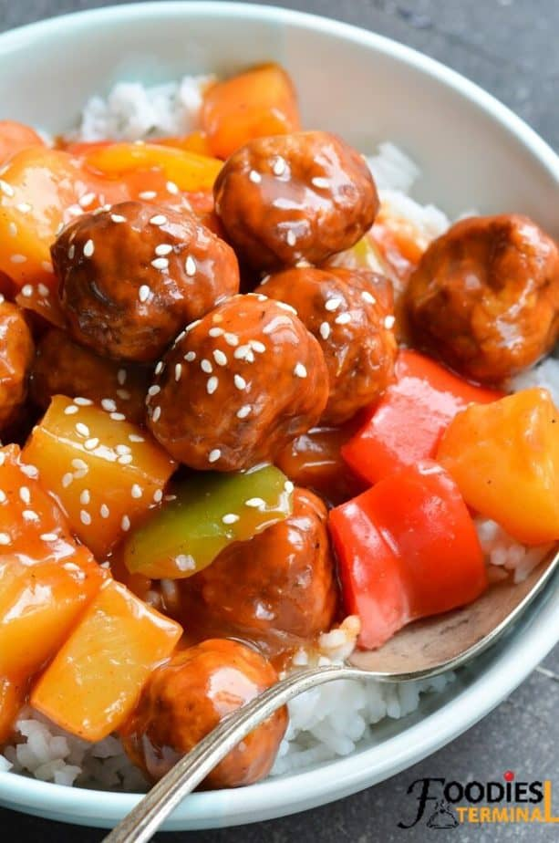 instant pot sweet and sour meatballs with pineapple on white rice with a spoon