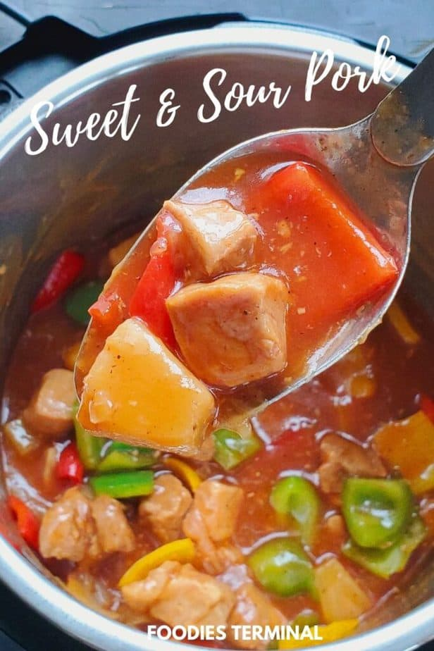 sweet and sour pork with pineapple in a ladle