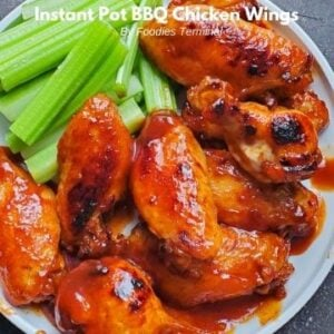 instant pot bbq chicken wings served on a white plate with celery sticks