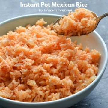 fluffy mexican rice instant pot recipe in a light blue plate with a spoon
