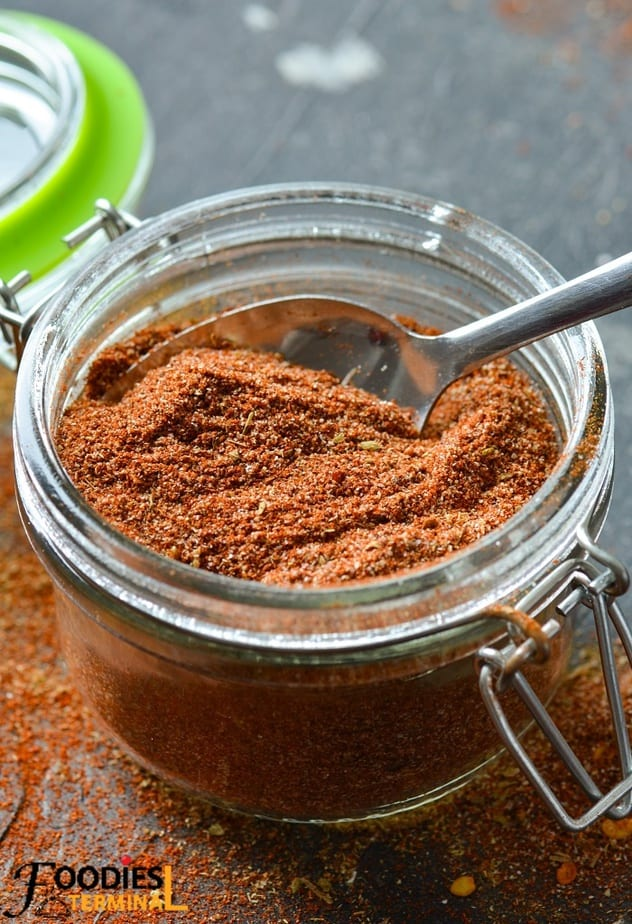 salt free fajita seasoning in a glass container with a spoon