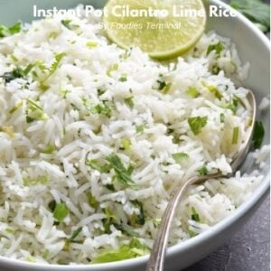 chipotle cilantro lime rice in a light blue plate with a spoon and lime