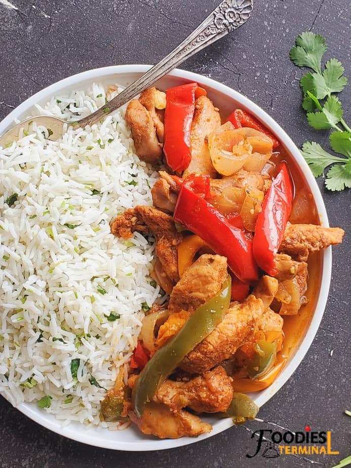 instant pot chicken fajitas served with cilantro lime rice on a white plate