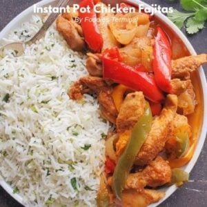 Fajita chicken instant pot recipe served with cilantro lime rice on a white plate