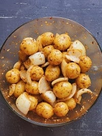 marinated baby potatoes in a glass bowl