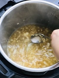deglazing pot with a steel ladle